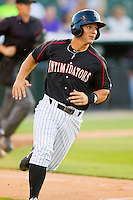 Eric Grabe (18) of the Kannapolis Intimidators hustles down the first base line against the Savannah Sand Gnats at CMC-Northeast Stadium on May 30, 2013 in Kannapolis, North Carolina. The Intimidators defeated the San Gnats 5-4 in 11 innings..   (Brian Westerholt/Four Seam Images)