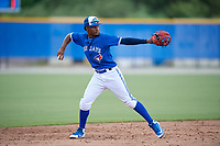 GCL Blue Jays shortstop Orelvis Martinez (18) throws to first base during a Gulf Coast League game against the GCL Tigers West on August 3, 2019 at the Englebert Complex in Dunedin, Florida.  GCL Blue Jays defeated the GCL Tigers West 4-3.  (Mike Janes/Four Seam Images)
