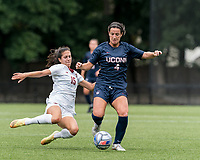 NEWTON, MA - AUGUST 29: Samantha Agresti #15 of Boston College tackles Lucy Cappadona #4 of University of Connecticut during a game between University of Connecticut and Boston College at Newton Campus Soccer Field on August 29, 2021 in Newton, Massachusetts.
