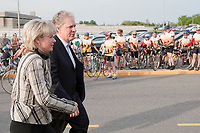 Quebec Minister of Transport Julie Boulet and Quebec Premier Jean Charest arrive at the Ride in Silence event in Quebec City May 19, 2010. Ride in Silence is a worldwide event being held tonight to honor those injured or killed while cycling on public roads.<br /> <br /> PHOTO :  Francis Vachon - Agence Quebec Presse