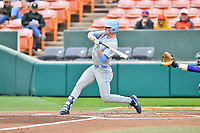 North Carolina Tar Heels designated hitter Jackson Hesterlee (26) checks his swing during a game against the Clemson Tigers at Doug Kingsmore Stadium on March 9, 2019 in Clemson, South Carolina. The Tigers defeated the Tar Heels 3-2 in game one of a double header. (Tony Farlow/Four Seam Images)