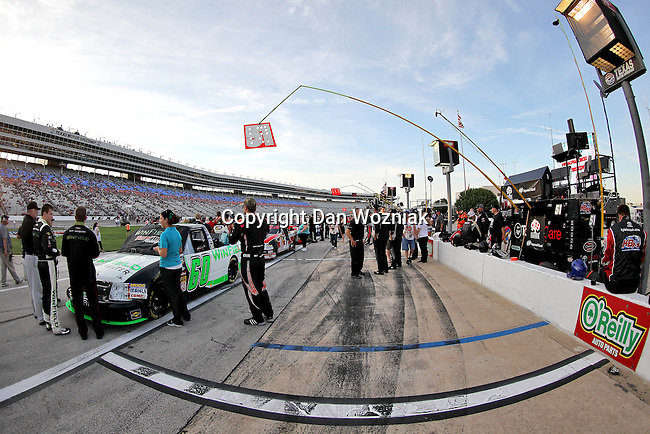 Camping World Truck Series drivers get ready for action before the NCWTS Winstar World Casino 400 race at Texas Motor Speedway in Fort Worth,Texas.