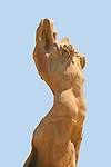 Public art: side female torso. Bronze statue