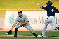First baseman Kevin Barker #39 stretches for a throw as Miguel Negron #4 of the Charlotte Knights hits the bag at Knights Stadium June 23, 2009 in Fort Mill, South Carolina. (Photo by Brian Westerholt / Four Seam Images)