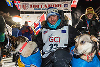 Joar Leifseth Ulsom congratulates his leaders at the finish line in Nome, Alaska early on Wednesday morning March 14th as he wins the 46th running of the 2018 Iditarod Sled Dog Race.  He finished in 9 days 12 hours 00 minutes and 00 seconds<br /> <br /> Photo by Jeff Schultz/SchultzPhoto.com  (C) 2018  ALL RIGHTS RESERVED