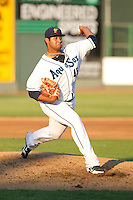 Luiz Gohara #45 of the Everett AquaSox delivers a pitch during a game against the Salem-Keizer Volcanoes at Everett Memorial Stadium in Everett, Washington on July 9, 2014.  Salem-Keizer defeated Everett 6-4.  (Ronnie Allen/Four Seam Images)