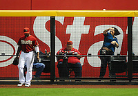 May 9, 2012; Phoenix, AZ, USA; A fan (right) throws back the home run ball hit by St. Louis Cardinals first baseman Allen Craig (not pictured) in the ninth inning as Arizona Diamondbacks outfielder Justin Upton walks away at Chase Field. The Cardinals defeated the Diamondbacks 7-2. Mandatory Credit: Mark J. Rebilas-