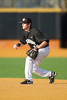 Second baseman Conor Keniry #14 of the Wake Forest Demon Deacons on defense against the Western Carolina Catamounts at Gene Hooks Field on February 22, 2011 in Winston-Salem, North Carolina.  Photo by Brian Westerholt / Four Seam Images