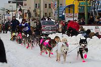 2010 Iditarod Ceremonial Start in Anchorage Alaska musher # 22 JANE FAULKNER with Iditarider JEFF HAZELWOOD