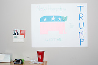 """A sign reads """"New Hampshire Women for Trump"""" in the campaign headquarters of Republican presidential candidate Donald Trump in Manchester, New Hampshire, on the day of the primary, Tues., Feb. 9, 2016. Donald Trump won the primary."""