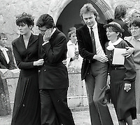 Pix: Copyright Anglia Press Agency/Archived via SWpix.com. The Bamber Killings. August 1985. Murders of Neville and June Bamber, daughter Sheila Caffell and her twin boys. Jeremy Bamber convicted of killings serving life...copyright photograph>>Anglia Press Agency>>07811 267 706>>..Jeremy Bamber is comforted by his girlfriend Julie Mugford at the funeral of his family, alongside Colin Caffell, father and husband of victims. no date..ref 0006 neg 17..