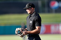 Umpire Dillon Wilson prepares to get behind the plate for the game between the Rocket City Trash Pandas and the Tennessee Smokies at Smokies Stadium on June 12, 2021, in Kodak, Tennessee. (Danny Parker/Four Seam Images)
