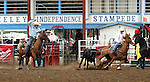 Greeley, Colorado - 7/04/2009 - Copyright Rick Davis - PRCA cowboys Trevor Brazille of Decatur, Texas, and heeler Patrick Smith of Midland, Texas turned in a 4.9 second short go team roping time during short go round action of the 87th annual Greeley Stampede Rodeo.  A 15.8 second score on three head earned the team the 2009 Team Roping Championship.