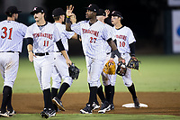 Micker Adolfo (27) of the Kannapolis Intimidators high fives his teammates after their win over the Hagerstown Suns at Kannapolis Intimidators Stadium on June 14, 2017 in Kannapolis, North Carolina.  The Intimidators defeated the Suns 10-1 in game two of a double-header.  (Brian Westerholt/Four Seam Images)
