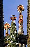 Sagrada Familia, Church of the Holy Family,  Barcelona, Spain.  Detail of the finials of spires and steeples between the two towers of the incomplete cathedral designed by Antonio Gaudi..