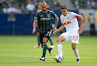 CARSON, CA - APRIL 25: Caden Clark #27 of New York Red Bulls passes off a ball during a game between New York Red Bulls and Los Angeles Galaxy at Dignity Health Sports Park on April 25, 2021 in Carson, California.