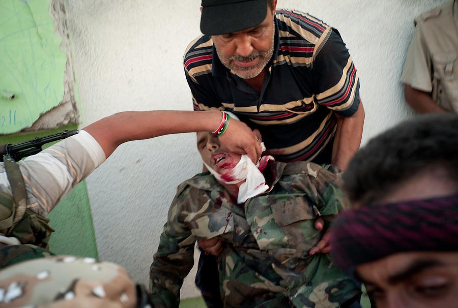 Rebel casualty in the Bab Al Aziziya compound in Tripoli, Libya