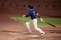 Mobile BayBears shortstop Hutton Moyer (11) follows through on a swing during a game against the Chattanooga Lookouts on May 5, 2018 at Hank Aaron Stadium in Mobile, Alabama.  Chattanooga defeated Mobile 11-5.  (Mike Janes/Four Seam Images)
