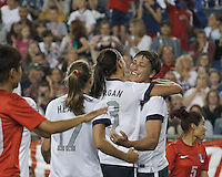 USWNT substitute forward Abby Wambach (20) celebrates her goal with teammates. In an international friendly, the U.S. Women's National Team (USWNT) (white/blue) defeated Korea Republic (South Korea) (red/blue), 4-1, at Gillette Stadium on June 15, 2013.