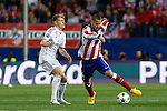 Atletico de Madrid's Mario Suarez (R) and Real Madrid´s Toni Kroos during quarterfinal first leg Champions League soccer match at Vicente Calderon stadium in Madrid, Spain. April 14, 2015. (ALTERPHOTOS/Victor Blanco)