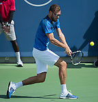 Jerzy Janowicz (POL) loses to Alexandr Dolgopolov (UKR), 6-3. 3-6, 6-4 at the Western and Southern Open in Mason, OH on August 20, 2015.