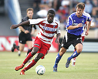 14 May 2005:  Eddie Johnson of FC Dallas dribbles the ball away from Eddie Robinson of Earthquakes during the first half of the game at Spartan Stadium in San Jose, California.  Earthquakes tied Dallas at 0-0.  Credit: Michael Pimentel / ISI