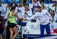 Bratislava, Slovenia, April 22, 2017,  FedCup: Slovakia-Netherlands, First rubber : Jana Cepelova (SVK) takes the first set and is congratulated by camtan Liptak<br /> Photo: Tennisimages/Henk Koster