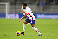 ORLANDO CITY, FL - JANUARY 31: Jonathan Lewis #14 of the United States turns with the ball during a game between Trinidad and Tobago and USMNT at Exploria stadium on January 31, 2021 in Orlando City, Florida.