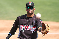 Wisconsin Timber Rattlers third baseman Sthervin Matos (9) tosses a ball in to the stands during a Midwest League game against the Kane County Cougars on May 16th, 2015 at Fox Cities Stadium in Appleton, Wisconsin.  Kane County defeated Wisconsin 4-2.  (Brad Krause/Four Seam Images)