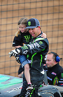 Mar. 20, 2011; Chandler, AZ, USA;  LOORRS pro two driver Jeremy McGrath celebrates with his daughter after finishing second in round two at Firebird International Raceway. Mandatory Credit: Mark J. Rebilas-
