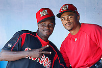 Batavia Muckdogs pitcher Jose Almarante #30 (left) and outfielder Virgil Hill #1 (right) during the first game of a doubleheader against the Mahoning Valley Scrappers at Dwyer Stadium on August 22, 2011 in Batavia, New York.  Batavia defeated Mahoning Valley 3-2 in extra innings.  (Mike Janes/Four Seam Images)