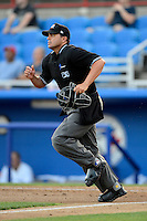 Umpire Fernando Rodriguez gets into position during a game between the Dunedin Blue Jays and Tampa Yankees on April 11, 2013 at Florida Auto Exchange Stadium in Dunedin, Florida.  Dunedin defeated Tampa 3-2 in 11 innings.  (Mike Janes/Four Seam Images)