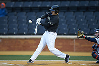Bobby Seymour (3) of the Wake Forest Demon Deacons makes contact with the baseball during the game against the Illinois Fighting Illini at David F. Couch Ballpark on February 16, 2019 in  Winston-Salem, North Carolina.  The Fighting Illini defeated the Demon Deacons 5-2. (Brian Westerholt/Four Seam Images)
