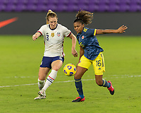 ORLANDO, FL - JANUARY 22: Sam Mewis #3 and Jorelyn Carabalí #16 battle for the ball during a game between Colombia and USWNT at Exploria stadium on January 22, 2021 in Orlando, Florida.
