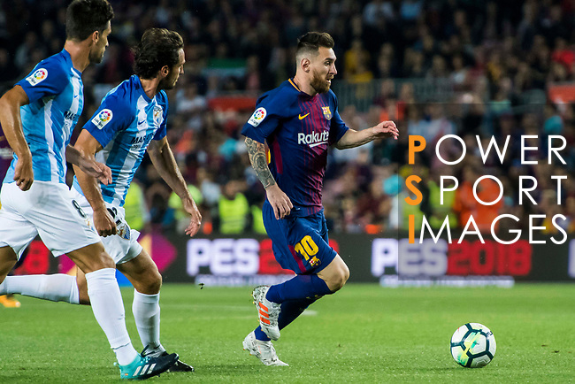 Lionel Andres Messi (r) of FC Barcelona is followed by Paul Baysse (c) and Adrian Gonzalez Morales of Malaga CF during the La Liga 2017-18 match between FC Barcelona and Malaga CF at Camp Nou on 21 October 2017 in Barcelona, Spain. Photo by Vicens Gimenez / Power Sport Images