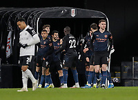 13th March 2021, Craven Cottage, London, England;  Manchester Citys players celebrate the goal by  John Stones for 0-1 in the 47th minute during the English Premier League match between Fulham and Manchester City at Craven Cottage in London