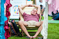 Hay on Wye, UK. Friday 27 May 2016<br /> A man has a nap on a deck chair at the Hay festival<br /> The 2016 Hay festival take place at Hay on Wye, Powys, Wales