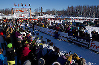 Sunday, March 4, 2012  Huge crowds of spectators line the starting chute and watch Martin Buser leave the restart of Iditarod 2012 in Willow, Alaska.