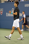 Novak Djokovic (SRB) defeats Mikhail Youzhny (RUS) 6-3, 6-2, 3-6, 6-0 at the US Open being played at USTA Billie Jean King National Tennis Center in Flushing, NY on September 5, 2013