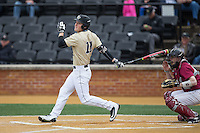 Jonathan Pryor (11) of the Wake Forest Demon Deacons follows through on his swing against the Harvard Crimson at David F. Couch Ballpark on March 5, 2016 in Winston-Salem, North Carolina.  The Crimson defeated the Demon Deacons 6-3.  (Brian Westerholt/Four Seam Images)