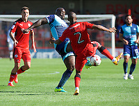 Adebayo Akinfenwa of Wycombe Wanderers goes in for a tackle with Lewis Young of Crawley Town during the Sky Bet League 2 match between Crawley Town and Wycombe Wanderers at Broadfield Stadium, Crawley, England on 6 August 2016. Photo by Alan  Stanford / PRiME Media Images.