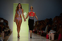 MIAMI BEACH, FL - JULY 21: Model walks the Toxic Sadie Swimwear fashion show during Mercedes-Benz Fashion Week Swim 2015 at Cabana Grande at The Raleigh on July 21, 2014 in Miami Beach, Florida. <br />