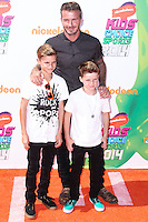 WESTWOOD, LOS ANGELES, CA, USA - JULY 17: David Beckham with sons Romeo James Beckham and Cruz David Beckham arrive at the Nickelodeon Kids' Choice Sports Awards 2014 held at UCLA's Pauley Pavilion on July 17, 2014 in Westwood, Los Angeles, California, United States. (Photo by Xavier Collin/Celebrity Monitor)