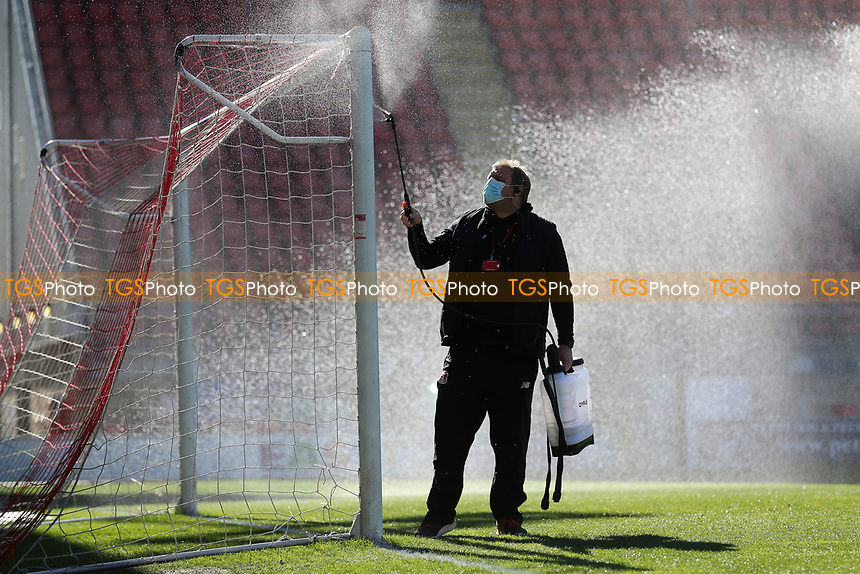 The goalposts are cleaned at half-time during Leyton Orient vs Walsall, Sky Bet EFL League 2 Football at The Breyer Group Stadium on 5th April 2021