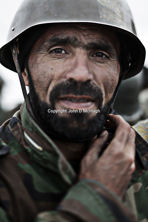 An Afghan National Army (ANA) soldier is seen training at Kabul Military Training Centre in Kabul, 14 February 2010. The KMTC is currently training 5,200 soldiers per month in a drive to build the Afghan National Army numbers up to the target of 134,000 soldiers by Oct 2010. (John D McHugh)