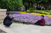 Yangzhou, Jiangsu, China.  Chinese Couple Making a Photo in Gardens of  Slender West Lake Park.