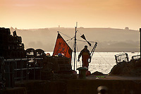 Fisherman preparing to go to sea at Padstow, Cornwall