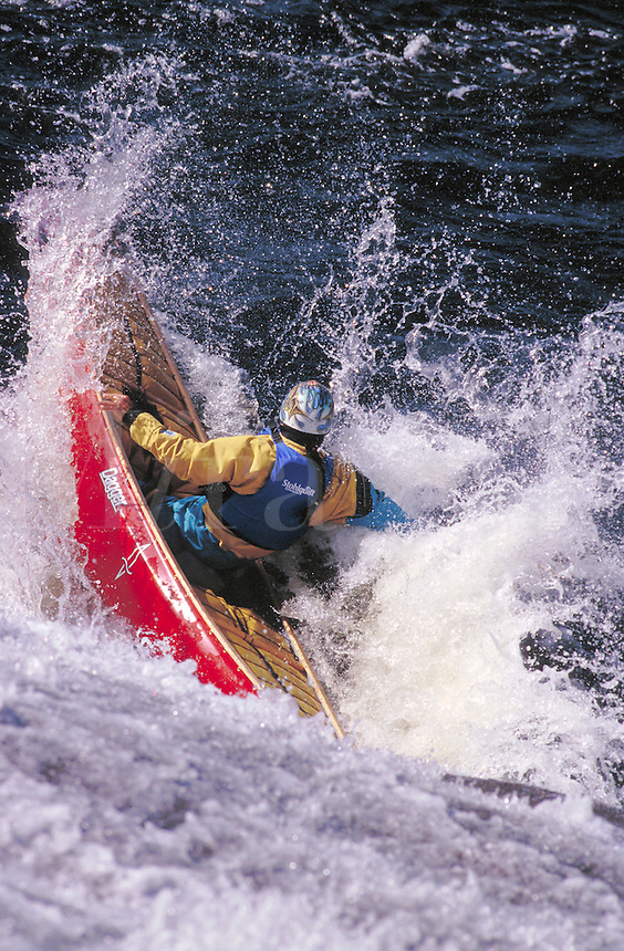 Whitewater canoe running Fowlerville Falls on the Moose River. Lyons Falls New York United States Moose River - Adirondacks.