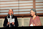 December 23, 2012, Tokyo, Japan - Emperor Akihito, accompanied by Empress Michiko, reads a statement to a throng of well-wishers from behind the bullet-proof glass panel of the Imperial Palace balcony in Tokyo on Sunday, December 23, 2012. More than 20,000 well-wishers turned out to the palace, celebrating the 79th birthday of the monarch, who said in his statement that he's concerned about the country's aging population. (Photo by AFLO) UUK -mis-