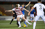 Hamilton Accies v St Johnstone …03.03.21   Fountain of Youth Stadium   SPFL<br />Brian Easton tackles Guy Melamed<br />Picture by Graeme Hart.<br />Copyright Perthshire Picture Agency<br />Tel: 01738 623350  Mobile: 07990 594431